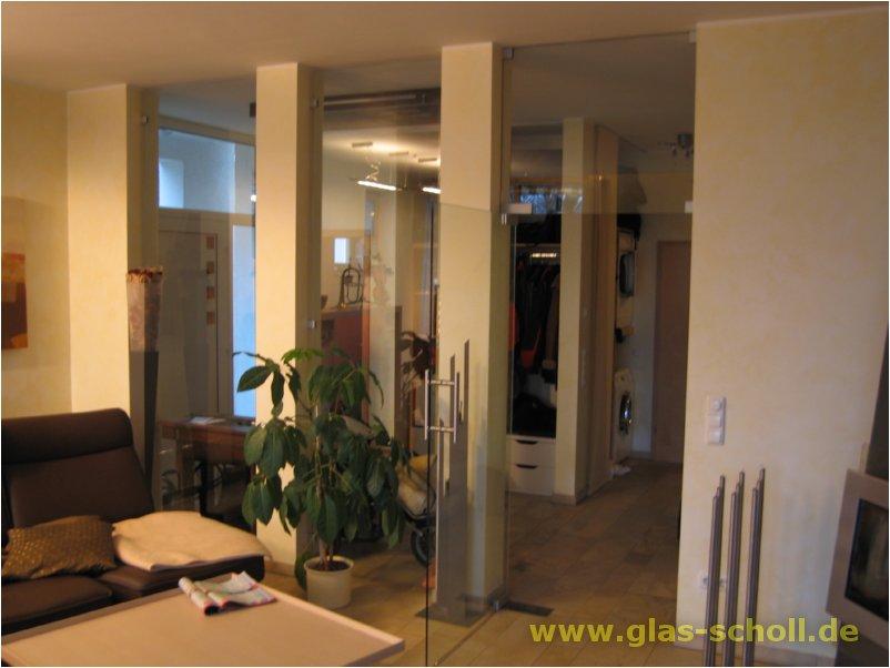 transparente rahmenlose ganzglas anlage t re mit oberlicht sowie zwei weitere festteilen. Black Bedroom Furniture Sets. Home Design Ideas